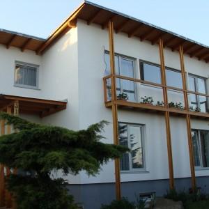 Rekonstrukce rodinného domu s nadstavbou ve formě dřevostavby