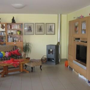 Obývací pokoj v dřevostavbě od firmy Bajulus